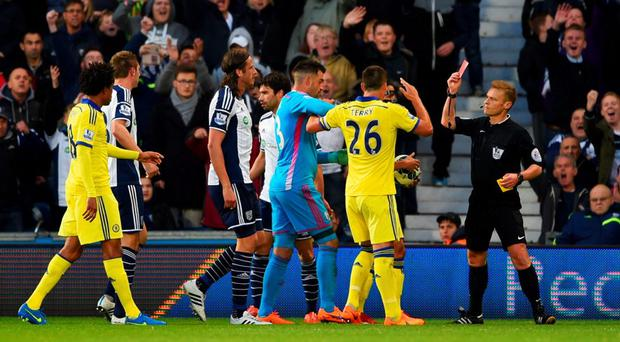 Referee Mike Jones shows a red card to Cesc Fabregas of Chelsea (obscured 2R)