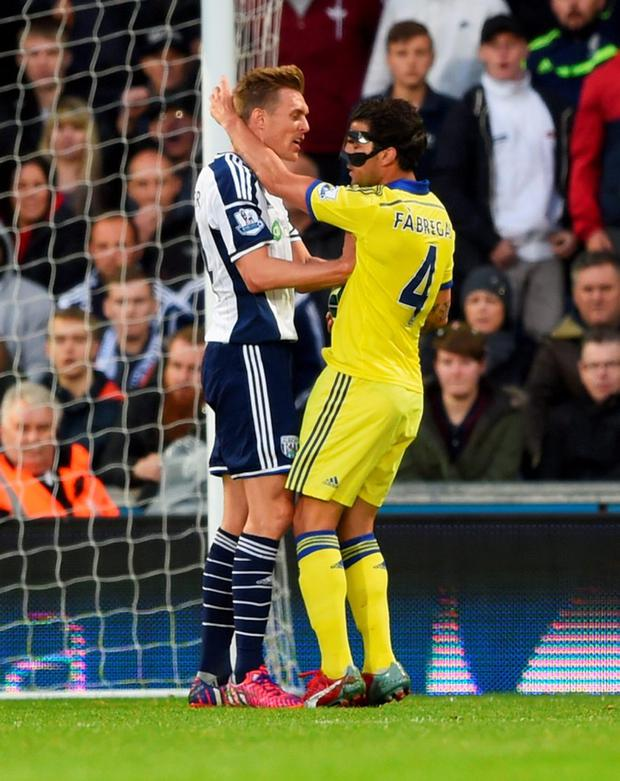 Cesc Fabregas and Darren Fletcher clash prior to Fabregas being sent off