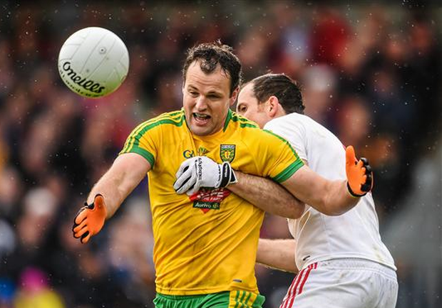 Michael Murphy, Donegal, in action against Justin McMahon, Tyrone during the Ulster GAA Football Senior Championship, Preliminary Round, Donegal v Tyrone (Stephen McCarthy / SPORTSFILE)