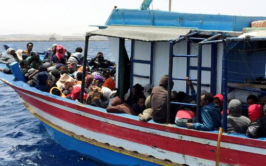 Illegal migrants who attempted to sail to Europe, sit in a boat carrying them back to Libya, after their boat was intercepted at sea by the Libyan coast guard, at Khoms. Libya's coast guard detained on Wednesday almost 600 illegal African migrants, among them pregnant women and 18 children, who had tried to sail to Europe on a fishing boat, a security official said (REUTERS/Aymen Elsahli)