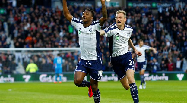 Darren Fletcher rushes to join in as Saido Berahino celebrates after scoring his first goal
