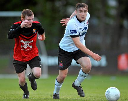 George Poynton, Dundalk, sprints ahead of UCC's Brian Murphy