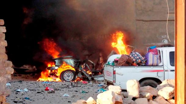 A car is engulfed by flames during clashes in the city of Ramadi. Photo: Reuters