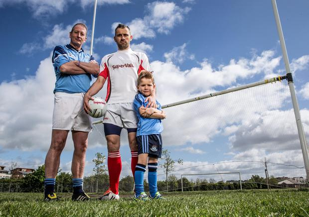 Dublin GAA football star Alan Brogan, his childhood hero Mick Galvin and Alan's son Jamie (6). Photo: ?INPHO/Billy Stickland