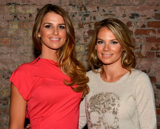 Vogue Williams McFadden & sister Amber Williams pose wearing Positive Energy Bangles before the Alex And Ani launch this evening in the Civic House on South William Street where Vogue will be DJing, Dublin, Ireland - 17.10.13. Pictures: Cathal Burke / VIPIRELAND.COM *** Local Caption *** Vogue Williams McFadden, Amber Williams