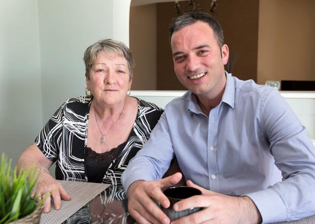Labour TD John Lyons pictured with his mother Josie at his Ballymun home