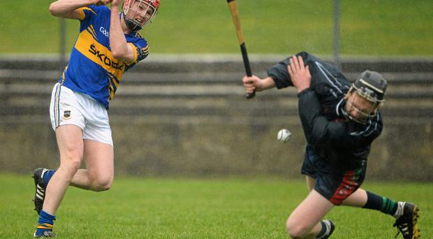 Aaron Murphy produces an acrobatic save to deny Tipperary's Shane Bourke