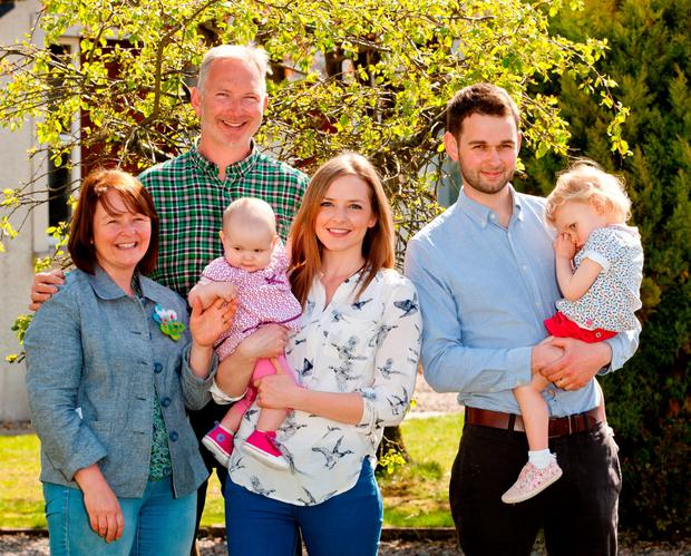 The Christian Institute of Ashers Baking Company owner Colin McArthur, 48, with his wife Karen, 45, and their son Daniel, 25, the General Manager of Ashers, with his wife Amy, 26, and their children Robyn (correct), aged two, and six-month-old Elia (correct), who were taken to court for refusing to make a cake bearing a pro-gay marriage slogan have said faith is sustaining them ahead of the judgment. PA Wire
