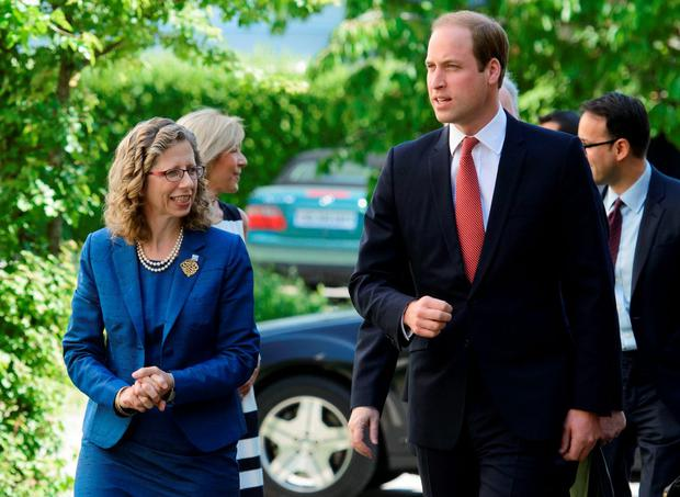 Prince William (R), Duke of Cambridge, is welcomed by IUCN Director General Inger Andersen (L) upon his arrival at the IUCN Conservation Centre
