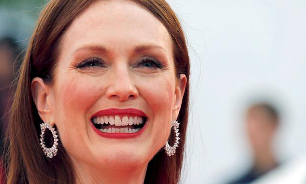 Actress Julianne Moore poses on the red carpet as she arrives for the screening of the film