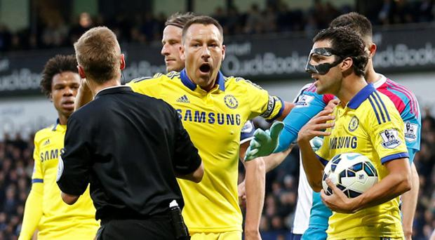Chelsea's Cesc Fabregas after being sent of by referee Mike Jones as John Terry looks on Action Images via Reuters / Carl Recine