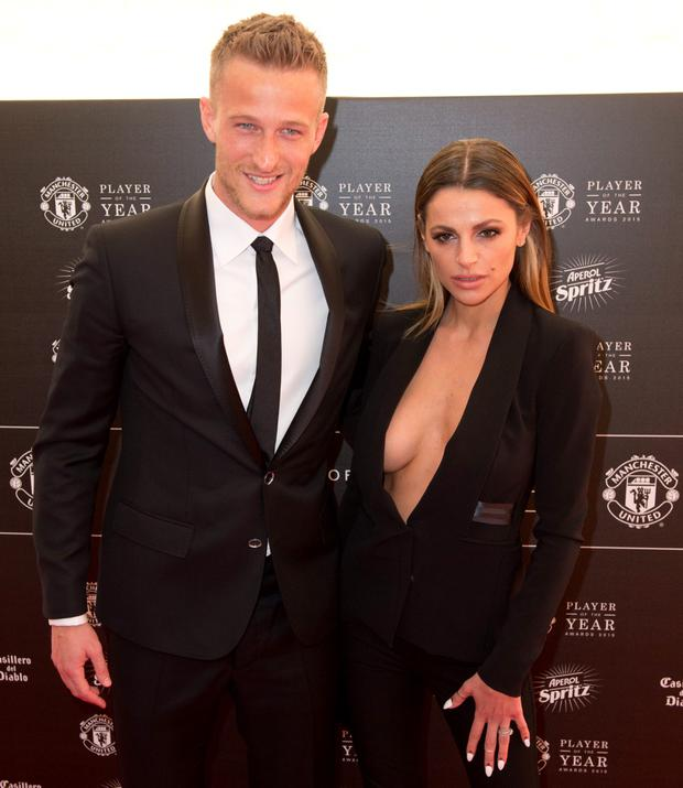 Manchester United's Danish goalkeeper Anders Lindegaard and his wife Misse pose for pictures on the red carpet as they arrive to attend the 'Manchester United Player of the Year Awards' at Old Trafford stadium in Manchester, northern England, on May 19, 2015. AFP PHOTO / OLI SCARFFOLI SCARFF/AFP/Getty Images