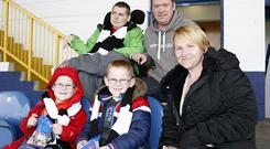Blue is the colour: The Emery family sit together at Stockport County's Edgeley Park