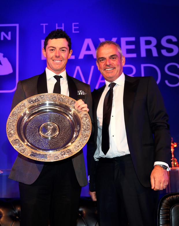 Rory McIlroy receives the Players Player Award from Paul McGinley