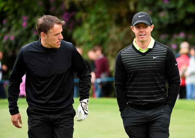 Rory McIlroy talks with Phil Neville during the Pro-Am ahead of the BMW PGA Championship at Wentworth on May 20, 2015 in Virginia Water, England. (Photo by Ross Kinnaird/Getty Images)