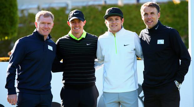 Rory McIlroy poses with Niall Horan of One Direction, Paul Scholes (L) and Phil Neville (R) during the Pro-Am ahead of the BMW PGA Championship at Wentworth on May 20, 2015 in Virginia Water, England. (Photo by Ian Walton/Getty Images)