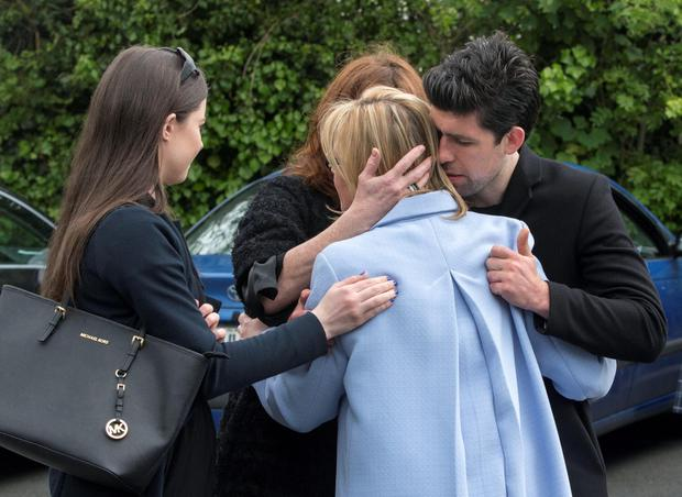 Ana Hick's mother Elga is comforted by the late DJ Gerry Ryans family including son Rex and wife Morah at her daughters funeral mass in the Church of the Assumption, Dalkey Pic:Mark Condren 20.5.2015