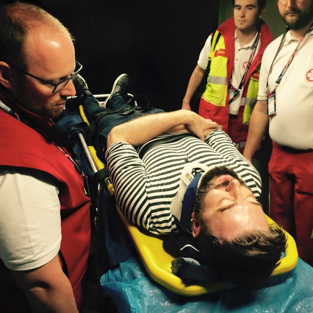 Karl Broderick in a neck brace and being treated by paramedics after he slipped on wet concrete steps at the Eurovision Song Contest in Austria and 'went flying'. Photo: Facebook
