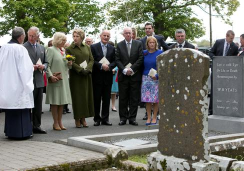 The Prince of Wales and The Very Revd Dean Arfon Williams at the grave of WB Yeats after attending a Service for Peace and Reconciliation at St. Columba's Church Drumcliff , Sligo on the second day their visit to the west of Ireland. Photo Chris Bellew / Fennell Photography