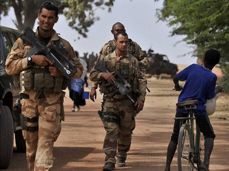 French soldiers patrol a street in Mali Credit: Reuters