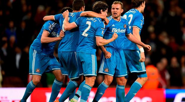 Billy Jones and Lee Cattermole of Sunderland celebrate securing Premier League safety