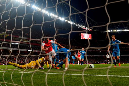 Sunderland survive another goalmouth scramble on their way to taking a point against Arsenal