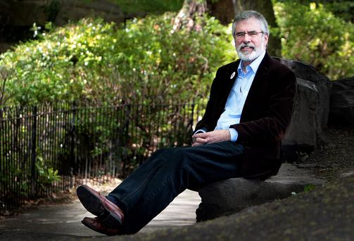 Sinn Féin president Gerry Adams takes a break in St Stephen's Green while canvassing for a 'Yes' vote in the marriage referendum yesterday. Photo: Tom Burke