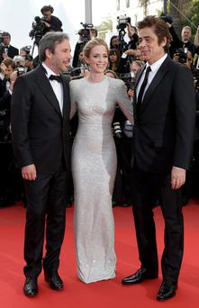 Director Denis Villeneuve, Emily Blunt and Benicio del Toro pose for photographers upon arrival for the screening of the film Sicario at the 68th international film festival, Cannes, southern France. (AP Photo/Thibault Camus)