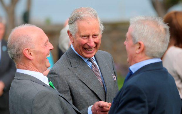 The Prince of Wales (centre) laughs as he is introduced to Lord Mountbatten's former staff , by Peter McHugh (left) as he arrives for a visit to Mullaghmore, in Sligo, on day two of a four day visit to Ireland