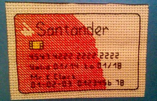 Santander have apologised after a customer made a bank card out of cross-stitch to protest at the delay in getting a replacement card. Image: Keith Clark