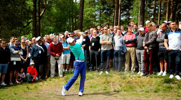 Rory McIlroy hits from a path on the 11th hole