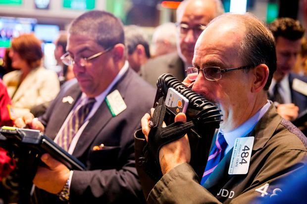 Traders work shortly after the opening bell on the floor of the New York Stock Exchange. Photo: Reuters