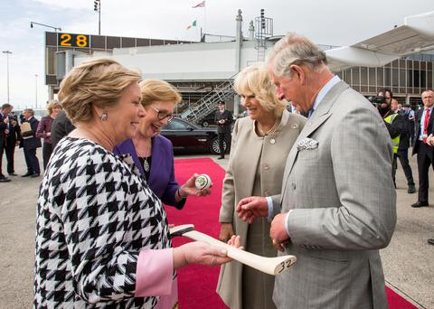 Justice Minister Frances Fitzgerald and Education Minister Jan O'Sullivan present Prince Charles and the Duchess of Cornwall with a hurley and sliotar at Shannon Airport as a present for Prince Charles's granddaughter Princess Charlotte. Photo: Sean Curtin