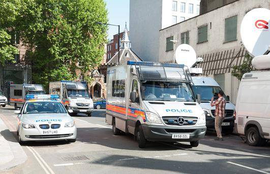 A convoy of police vans arrives at Westminster Magistrates Court in London transporting eight men who have been charged with conspiracy to burgle following the Hatton Garden jewellery raid