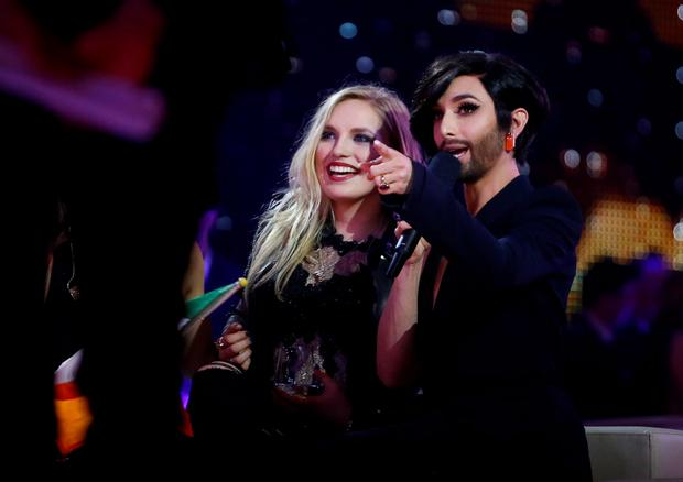 Singer Molly Sterling representing Ireland and last year's winner Conchita Wurst (R) of Austria react during the second semifinal of the upcoming 60th annual Eurovision Song Contest In Vienna, May 21, 2015