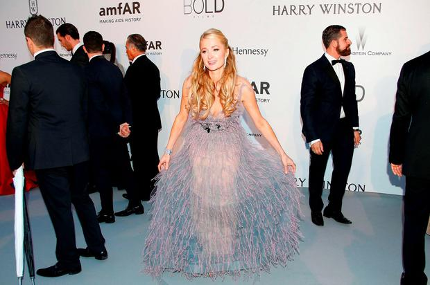 US entrepreneur and socialite Paris Hilton poses as she arrives for the amfAR 22st Annual Cinema Against AIDS during the 68th Cannes Film Festival