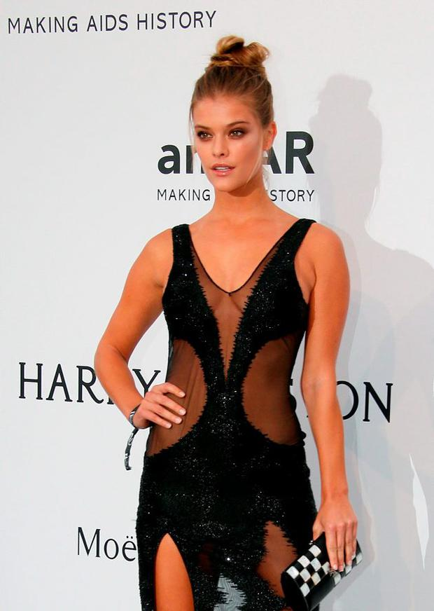 Danish model Nina Agdal poses as she arrives for the amfAR 22st Annual Cinema Against AIDS during the 68th Cannes Film Festival