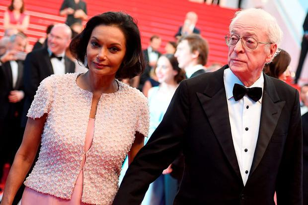 British actor Michael Caine (R) and his wife Shakira leave the Festival palace after the screening of the film