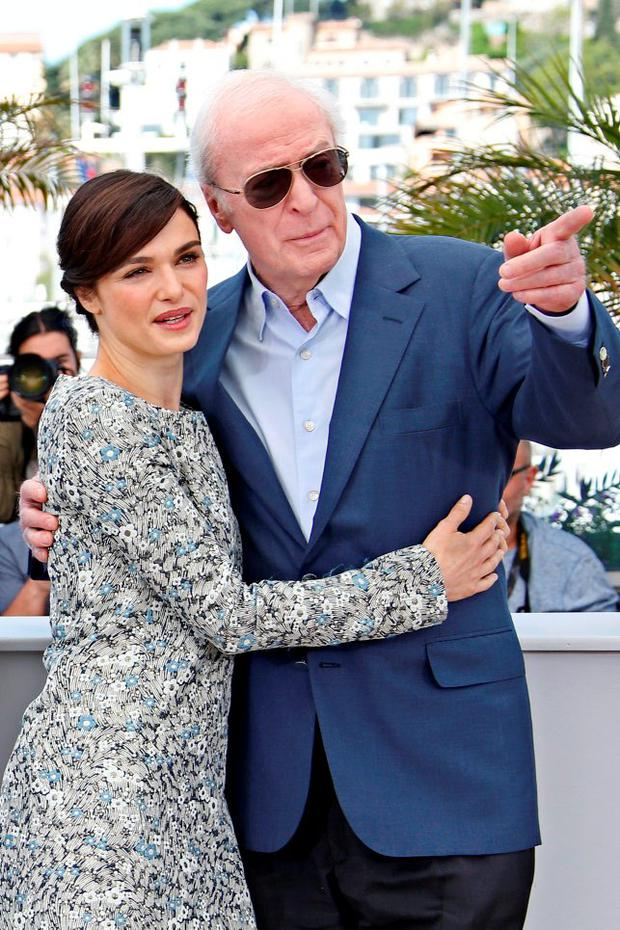 British actress Rachel Weisz (L) and British actor Michael Caine pose during a photocall for the film