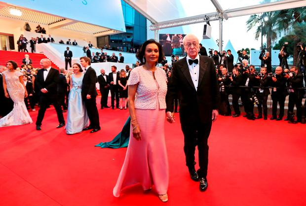 British actor Michael Caine (R) and his wife Shakira Caine leave the Festival palace after the screening of the film