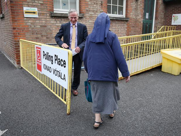 Minister Richard Bruton has a smile for Sr Loreto Ryan from the Sisters of Charity as they vote at the polling station at Drumcondra National School on Church Lane in Drumcondra. Photo: Frank Mc Grath