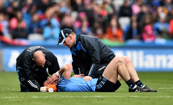 Dublin's Diarmuid Connolly is treated for an injury after an incident with Cork's Jamie O'Sullivan during the National League Final