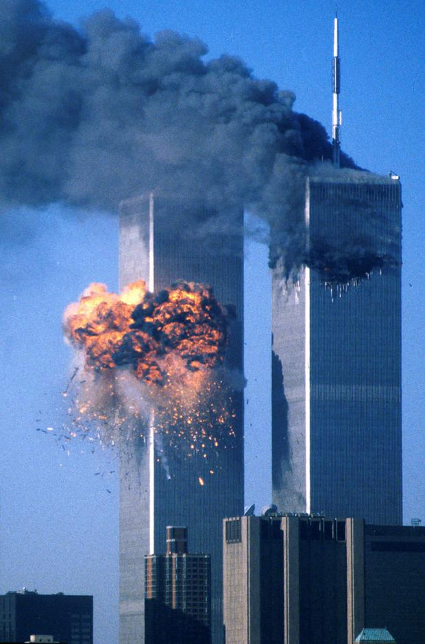 The World Trade Center south tower (L) bursts into flames after being struck by hijacked United Airlines Flight 175