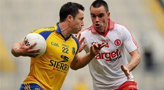 Ryan McMenamin, Tyrone, in action against David O'Gara, Roscommon, July 2011, who 'became a virtual poster-boy for sledging without any sense that his behaviour made Tyrone's senior management or players in any way uncomfortable' (Oliver McVeigh / SPORTSFILE)