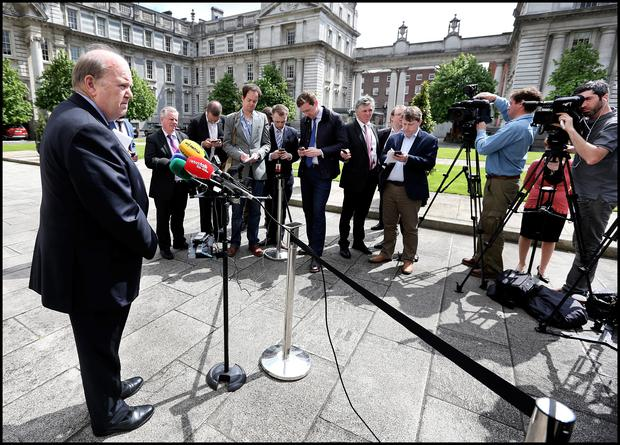 Minister for Finance Michael Noonan speaking to media at Government Buildings