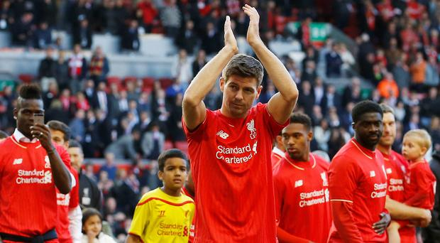 Liverpool's Steven Gerrard acknowledges the crowd as he walks on the pitch after his final game at Anfield (Reuters / Carl Recine)