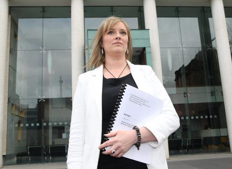 Mairia Cahill in Belfast with a copy of the report into how her sex abuse case was dealt with by the PPS.