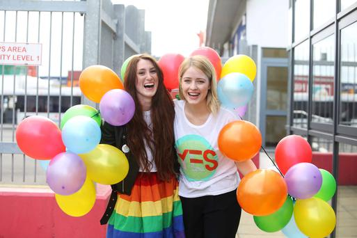 Hannah Little and Leanne Keogh from Dublin but living in London arrive home by boat for the same-sex marriage referendum. Photo: Sam Boal.