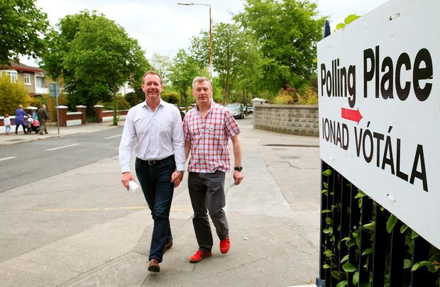 Civil partners of four years Paul Higgins and Richard Lucey, who have been in a relationship together for 19 years, arrive to cast their votes at their polling station in Cabra, Dublin for the referendum on gay marriage (Brian Lawless/PA Wire)