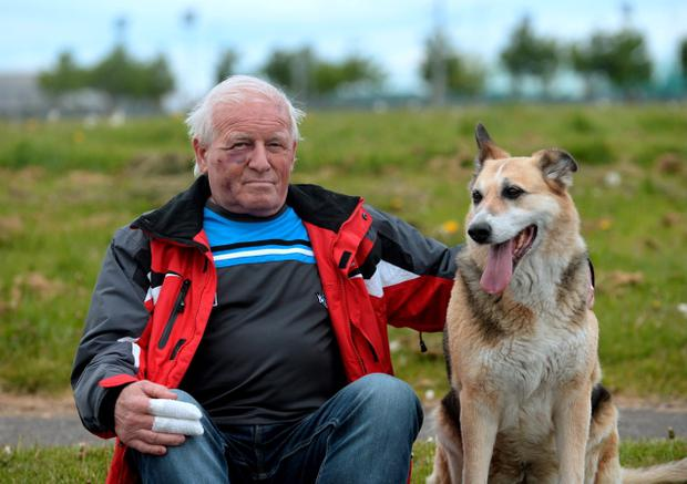 Injured Michael Browne with his dog Patch. Jobstown, Tallaght, Dublin. Picture: Caroline Quinn